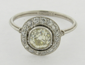 Light Yellow 1.02 Carat Old Cushion Cut Diamond Platinum Set Diamonds Halo Ring